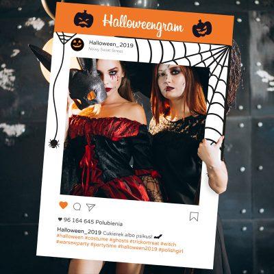 Two girls in halloween costumes in studio